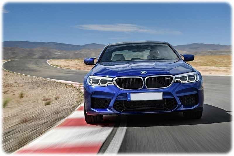 New 2018 BMW M5 front view driving on a track