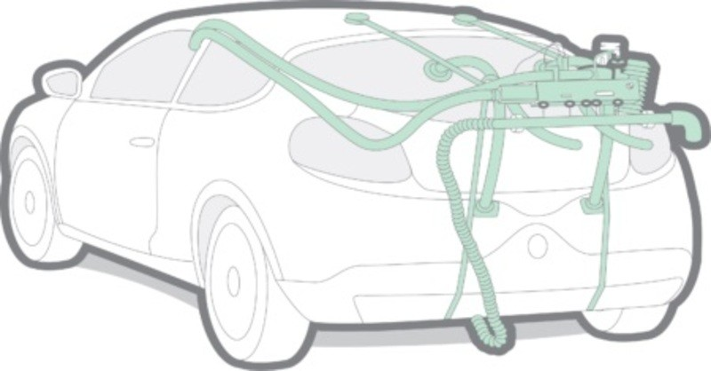 An illustration of a portable emissions test rig fixed on a car.