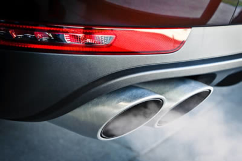 Close of car exhaust with emissions